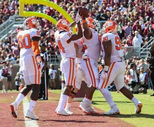 Clemson defensive lineman Christian Wilkins (42) celebrates with teammates after scoring against Florida State during the 2nd quarter Saturday, October 27, 2018 at Florida State's Doak Campbell Stadium in Tallahassee, Fl.