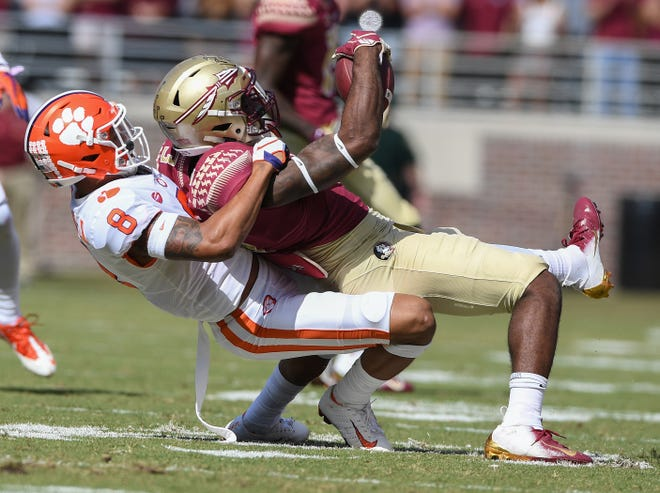 Clemson defensive back A.J. Terrell (8) brings down Florida State running back Cam Akers (3) during the 1st quarter Saturday, October 27, 2018 at Florida State's Doak Campbell Stadium in Tallahassee, Fl.