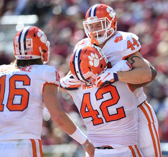 Clemson tight end Garrett Williams (44) celebrates with defensive lineman Christian Wilkins (42) after scoring against Florida State during the 2nd quarter Saturday, October 27, 2018 at Florida State's Doak Campbell Stadium in Tallahassee, Fl.