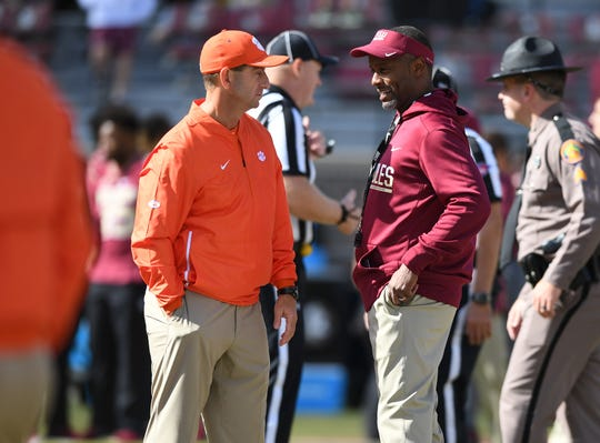 Clemson head coach Dabo Swinney talks with Florida State head coach Willie Taggart during pregame at Florida State's Doak Campbell Stadium in Tallahassee, Fl, Saturday, October 27, 2018