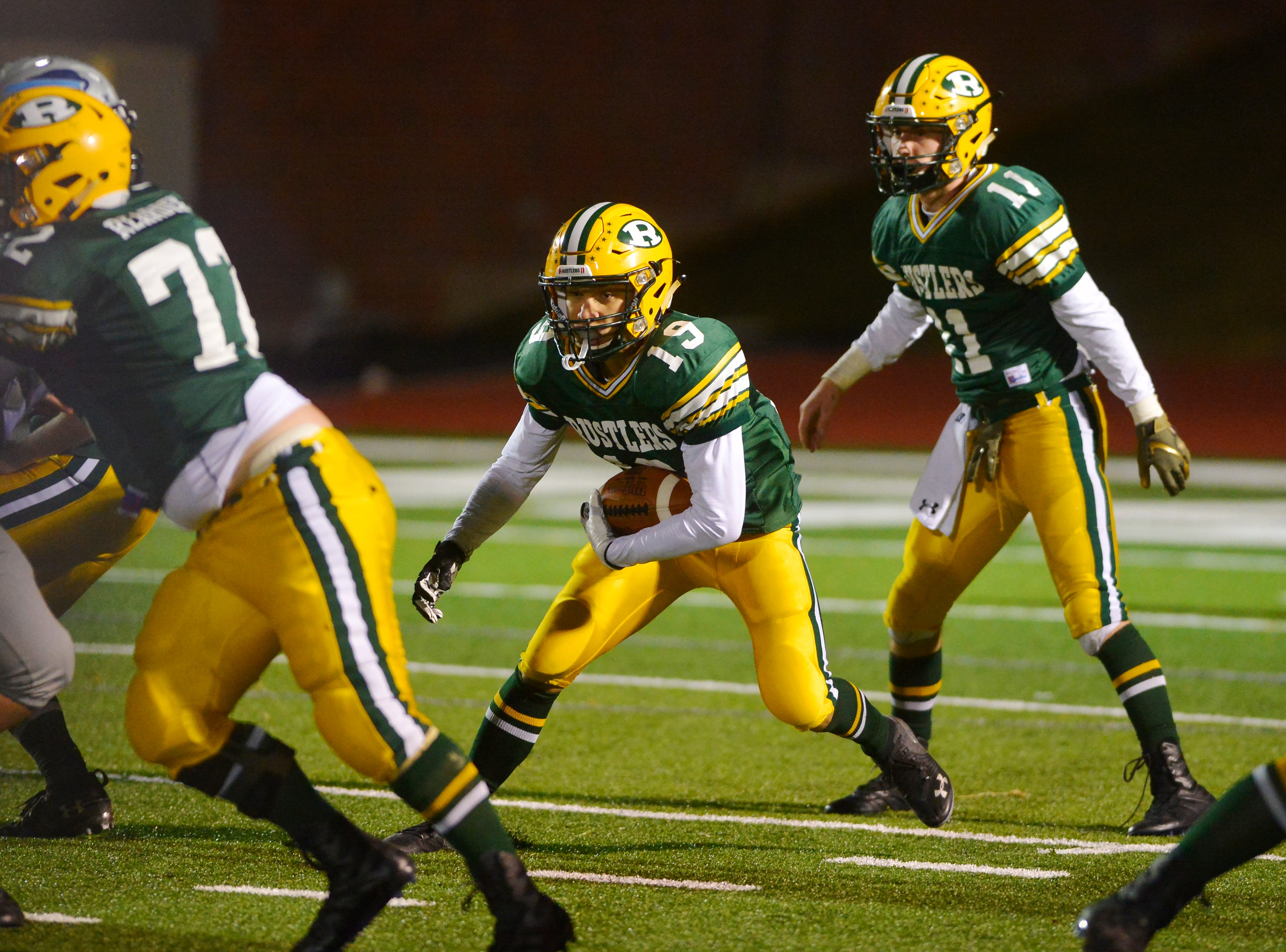 CMR's Logan Richard carries the football during the crosstown football game between Great Falls High and CMR on Friday night at Memorial Stadium.