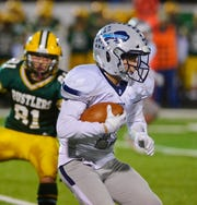 Great Falls High's Gabe Longin carries the ball during the crosstown football game between Great Falls High and CMR on Friday night at Memorial Stadium.