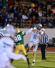 Great Falls High quarterback Blake Thelen throws downfield during the crosstown football game between Great Falls High and CMR last October at Memorial Stadium.