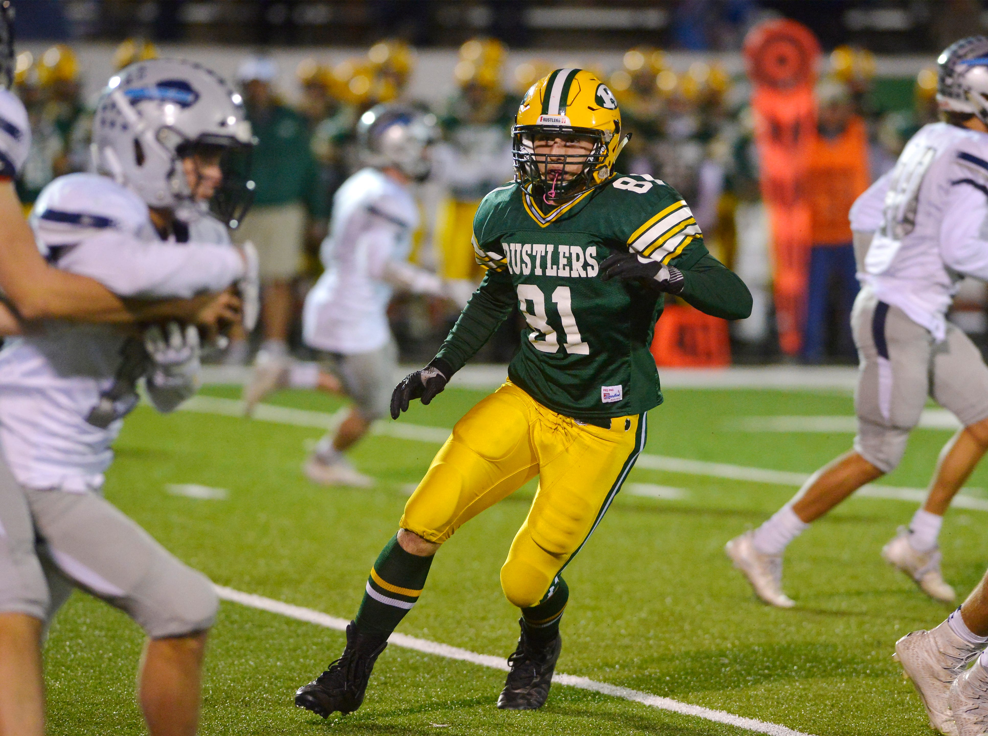 CMR's Hunter Clark looks for the ball carrier during the crosstown football game between Great Falls High and CMR on Friday night at Memorial Stadium.