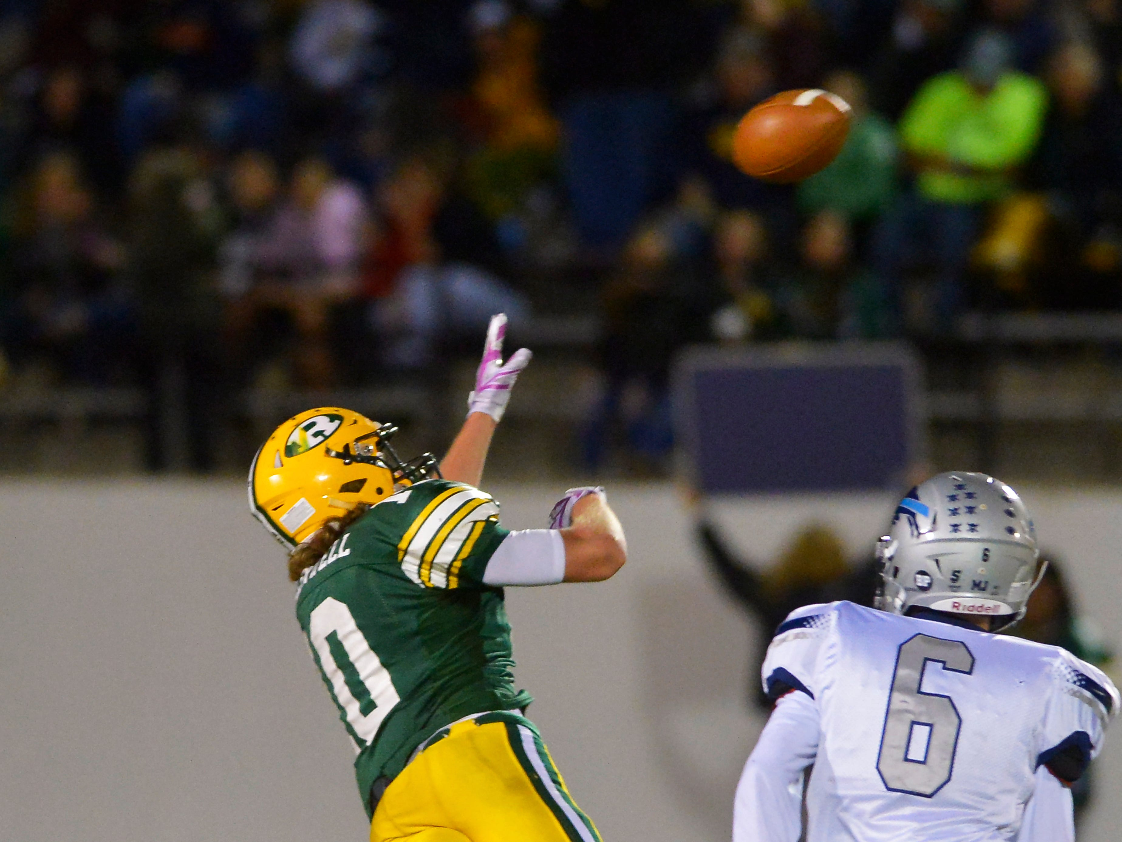 CMR's Tucker Greenwell lays out for a pass during the crosstown football game between Great Falls High and CMR on Friday night at Memorial Stadium.