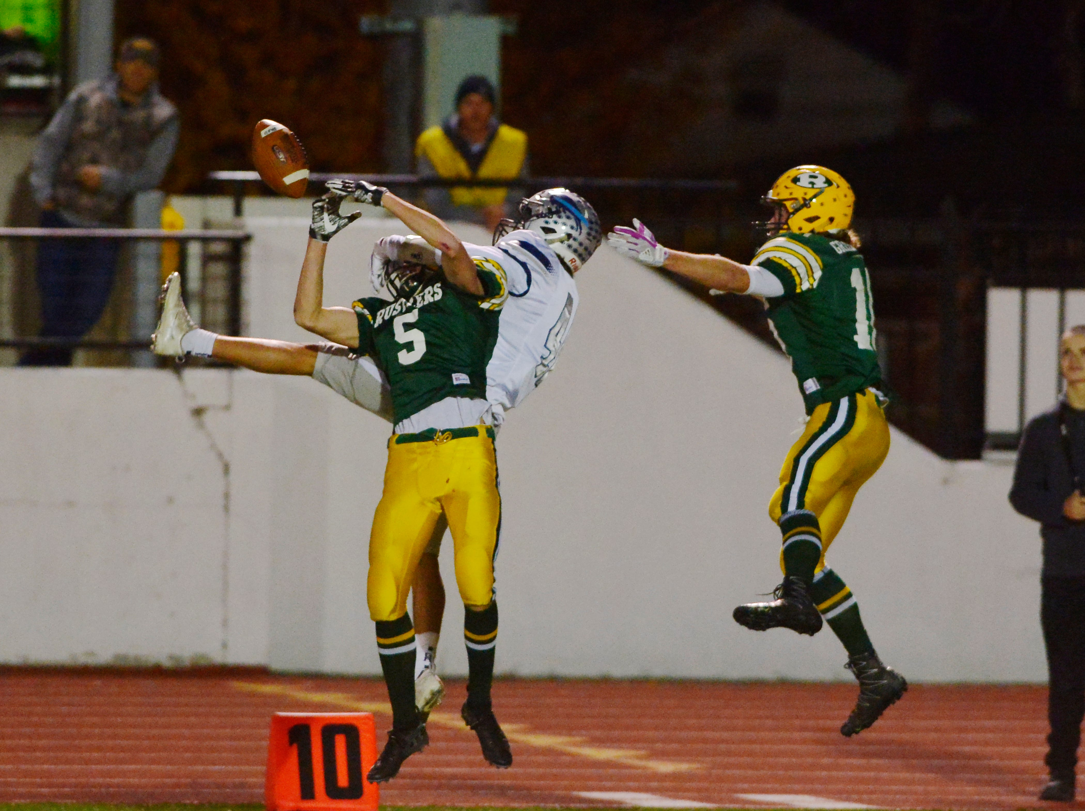 CMR's Kaden Gardner breaks up a pass intended for Kyle Torgerson during the crosstown football game between Great Falls High and CMR on Friday night at Memorial Stadium.