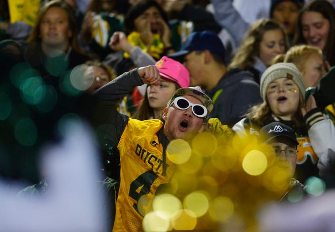 With COVID-19 restrictions in place, scenes like this from the 2018 Crosstown football game at Memorial Stadium will be more the exception than the rule. Fans from Class AA visiting towns won't be allowed to attend, while Helena and Billings won't allow any fans at their games.