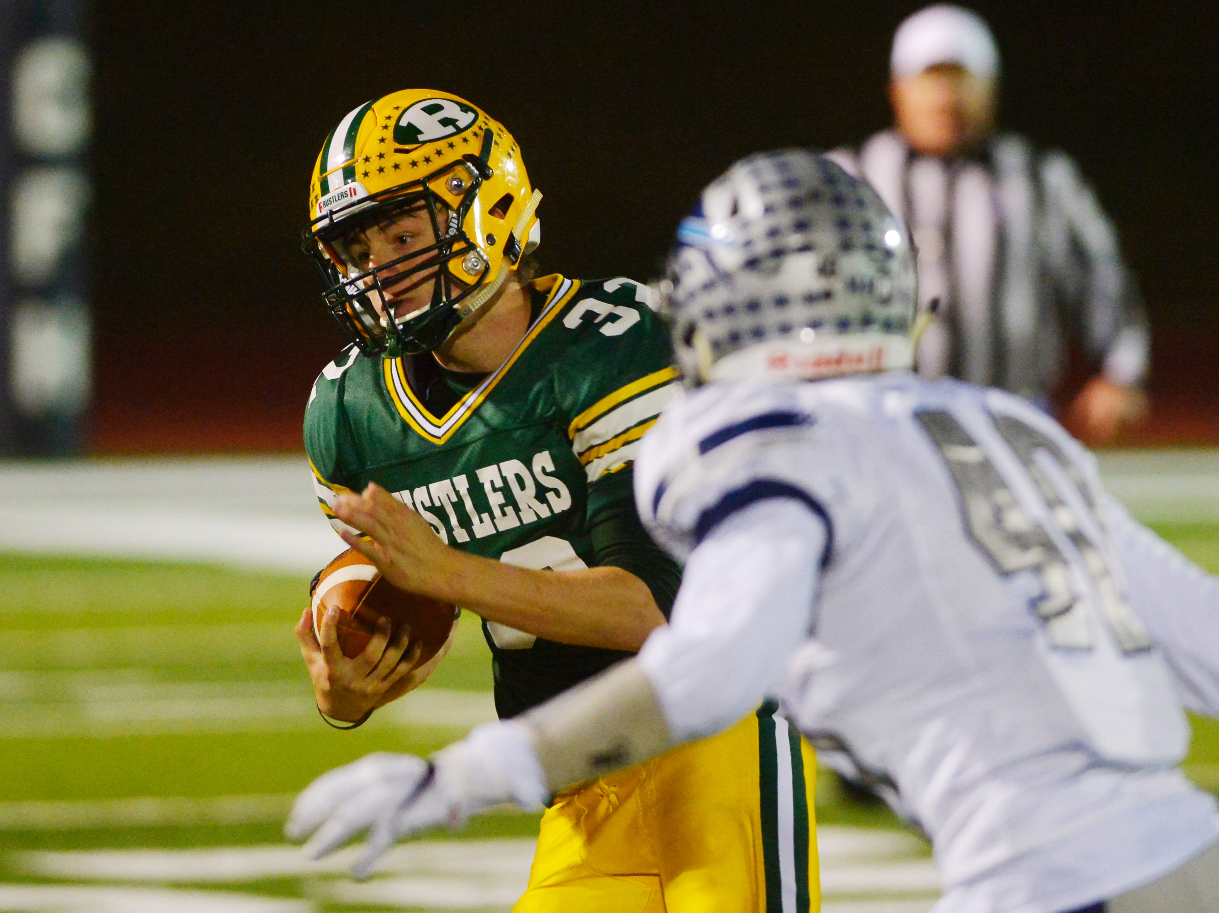 CMR's Jayson Ingalls carries the ball during the crosstown football game between Great Falls High and CMR on Friday night at Memorial Stadium.