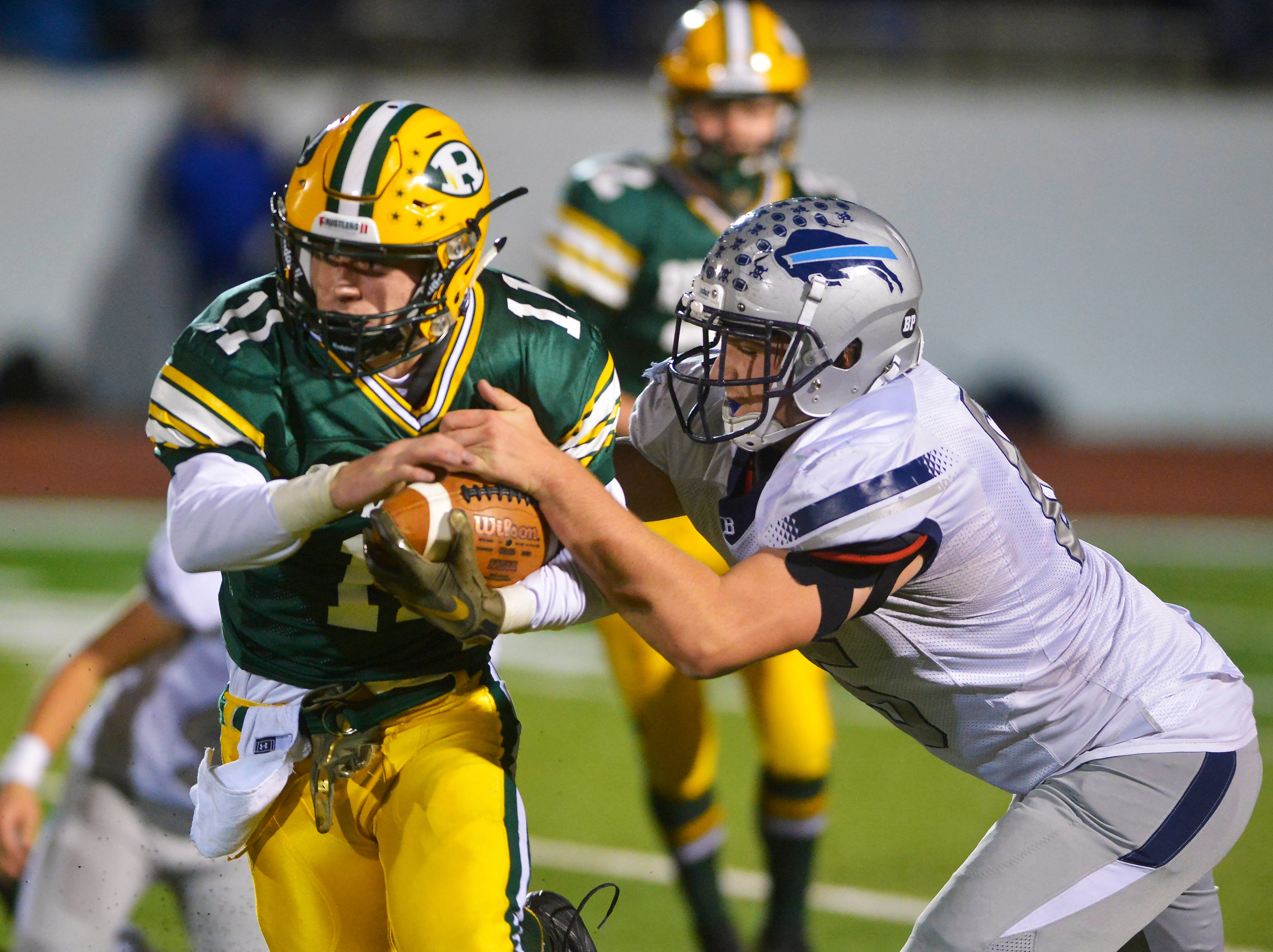 Great Falls High's Sam Potoczny attempts to bring down CMR's Bryce Nelson during the crosstown football game on Friday night at Memorial Stadium.