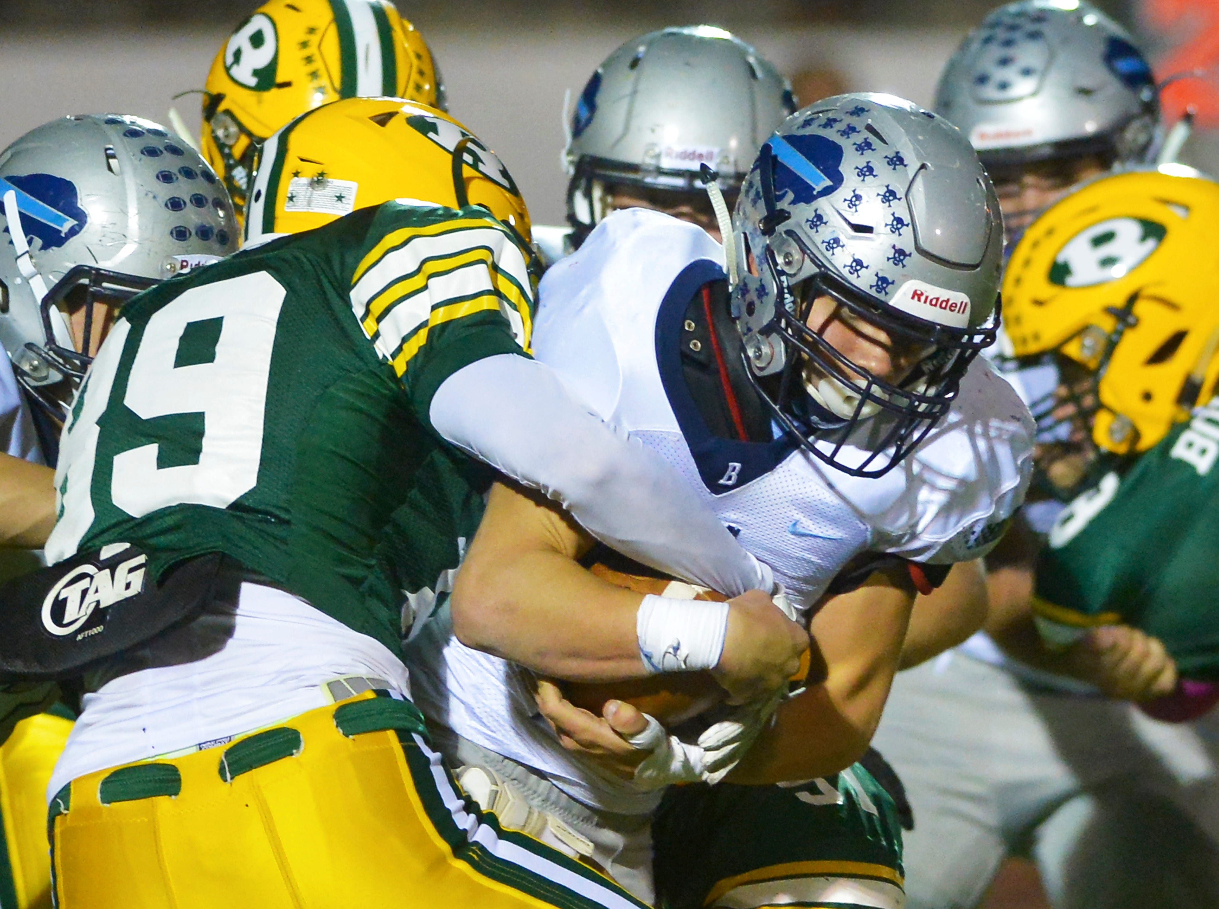 Great Falls High's Ben Held carries the ball during the crosstown football game between Great Falls High and CMR on Friday night at Memorial Stadium.