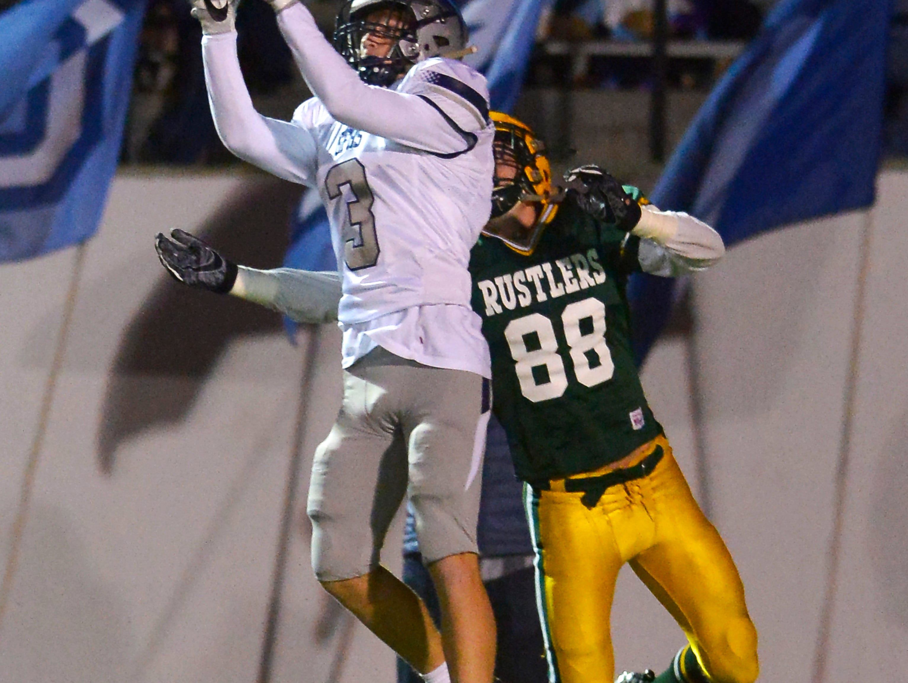 Great Falls High's Keegan Bistadeau makes an interception during the crosstown football game between Great Falls High and CMR on Friday night at Memorial Stadium.