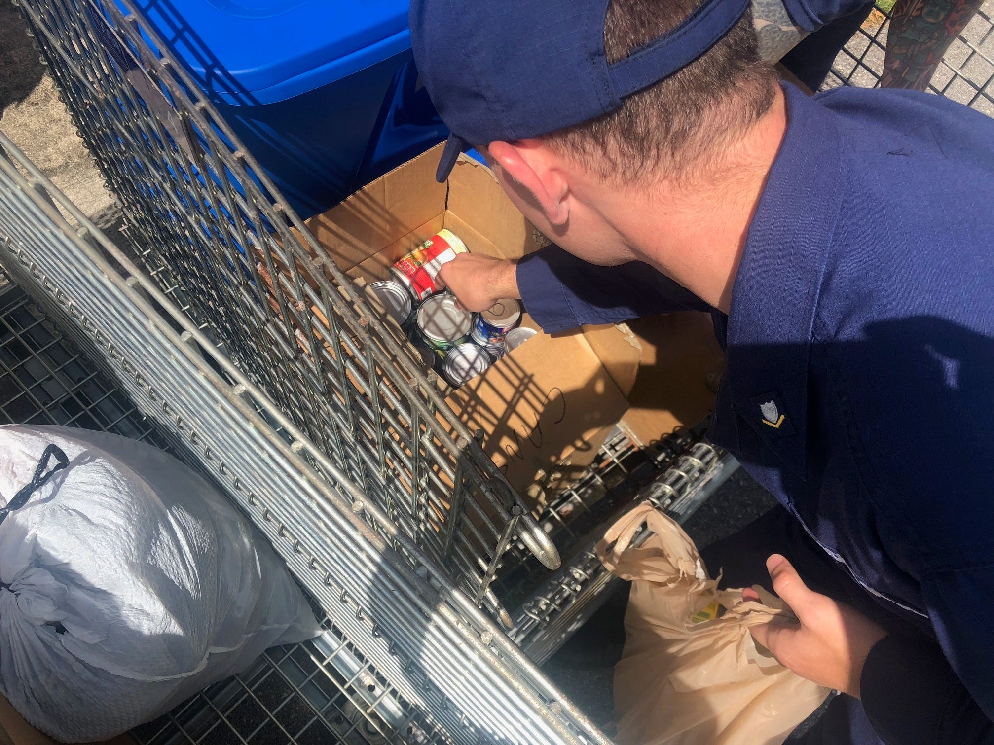 Crewmembers from Coast Guard Sector Guam pack canned good and other supplies to be transported to Saipan, Oct. 26, 2018. Members of the community on Guam donated many different supplies to sent for relief efforts to those effected by Typhoon Yutu.