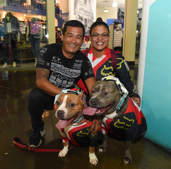 Tria and Dong Chong with their dogs Miso, left, and Star before the Feathers`N Fins annual Halloween Pet Costume Contest at Guam Premier Outlets, Oct. 27, 2018.