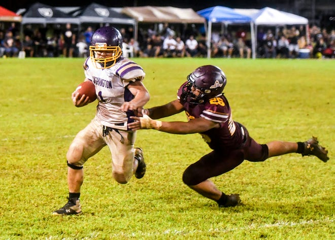 Helmets clashed and pads collided as the Father Duenas Friars and the George Washington Geckos embroiled in a hard-fought battle for the Interscholastic Athletic Association of Guam high school football title at the Geckos' field in Mangilao on Saturday, Oct. 27, 2018. The contest went into overtime but in the end, winning their 40th straight win and their fourth consecutive championship in the league, the Friars were once again victorious with a final score of 20-14, over the Geckos.