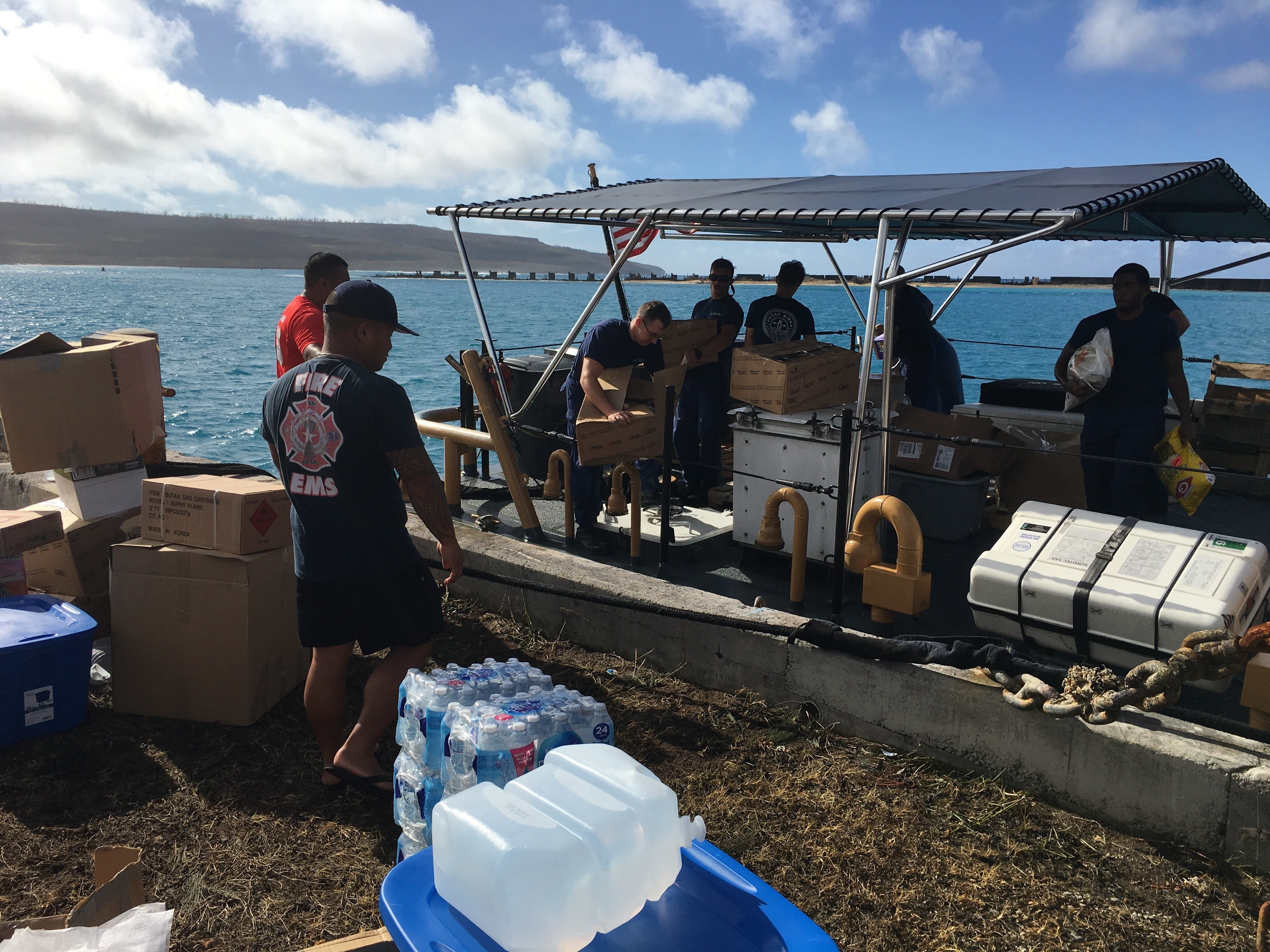 Crewmembers from U.S. Coast Guard Cutter Kiska (WPB 1336), based out of Guam, unload supplies in Saipan, Oct. 27, 2018.The crew will be transported donated goods from the community to those effected by Typhoon Yutu.