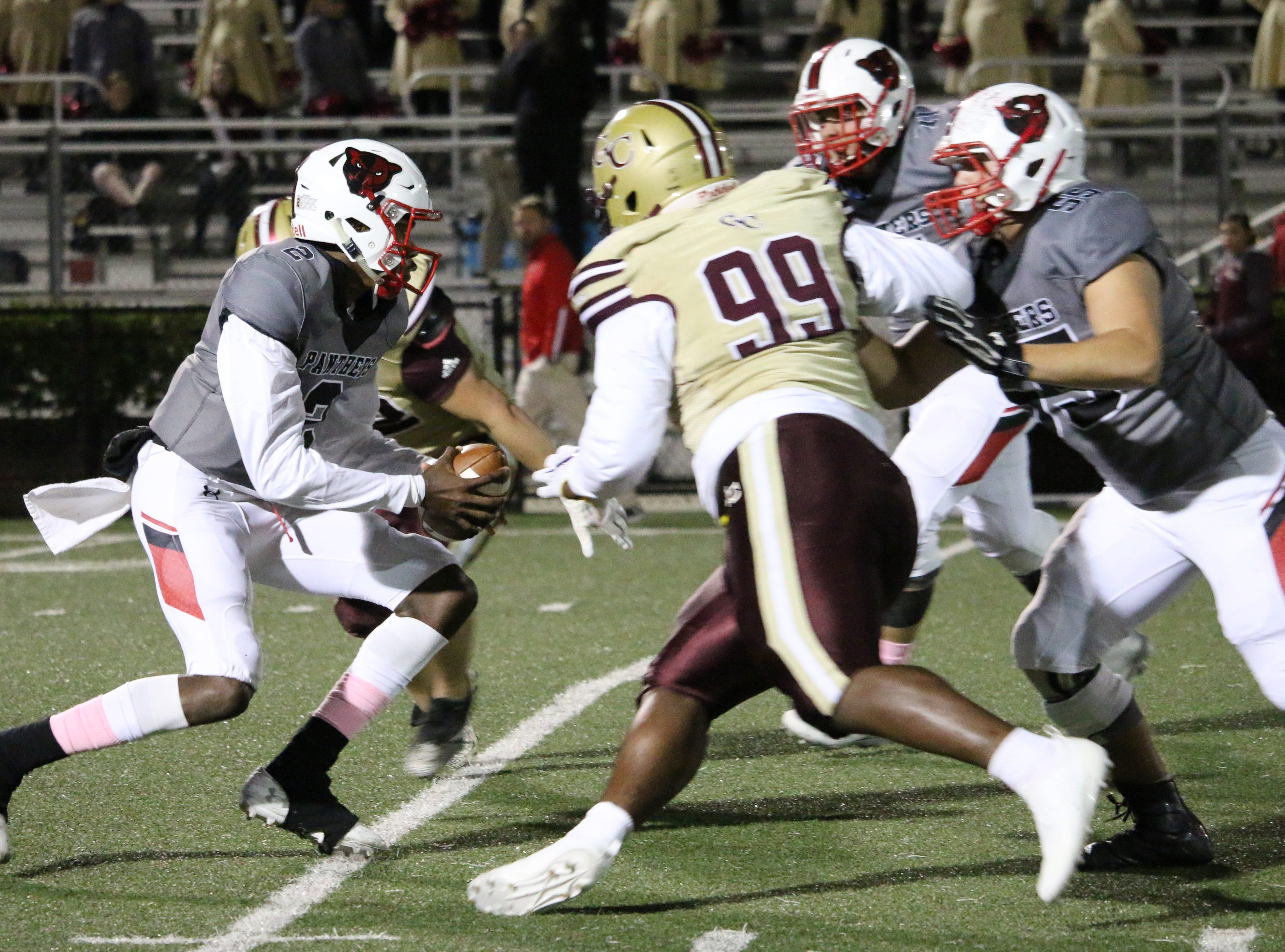 Petal quarterback Decarlos Nicholson avoids a tackle from George County's defense on Friday.