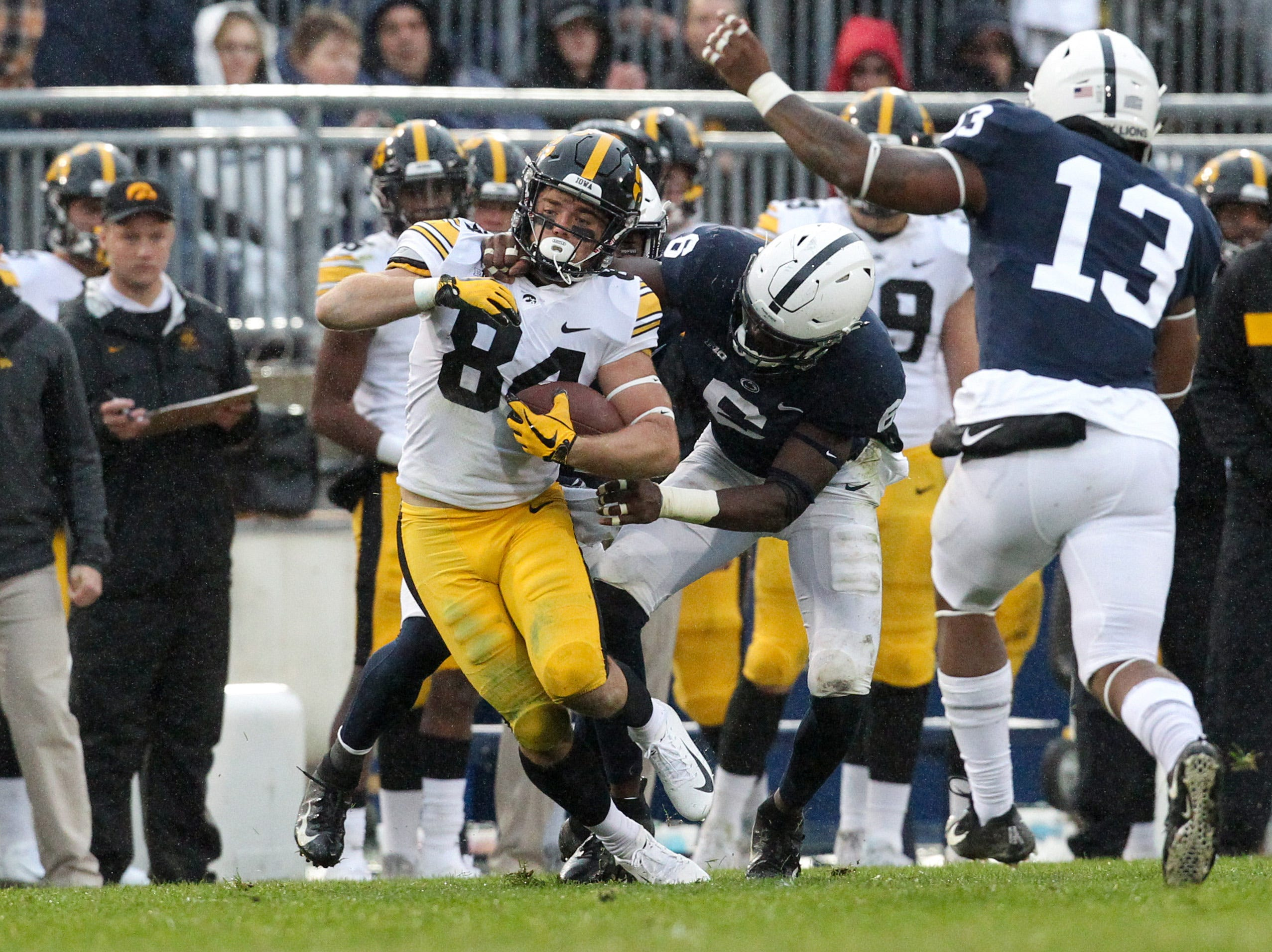 Oct 27, 2018; University Park, PA, USA; Iowa Hawkeyes wide receiver Nick Easley (84) runs the ball against Penn State Nittany Lions linebacker Cam Brown (6) during the second quarter at Beaver Stadium. Mandatory Credit: Matthew O'Haren-USA TODAY Sports