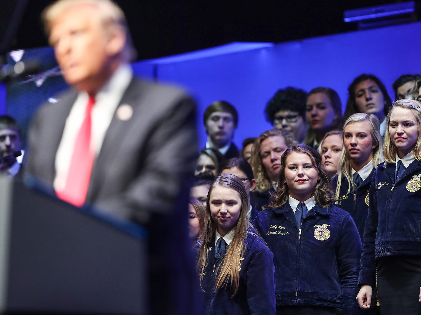 Attendees listen as President Donald Trump speaks to the annual Future Farmers of America Convention and Expo at Banker's Life Fieldhouse in Indianapolis, Saturday, Oct. 27, 2018.