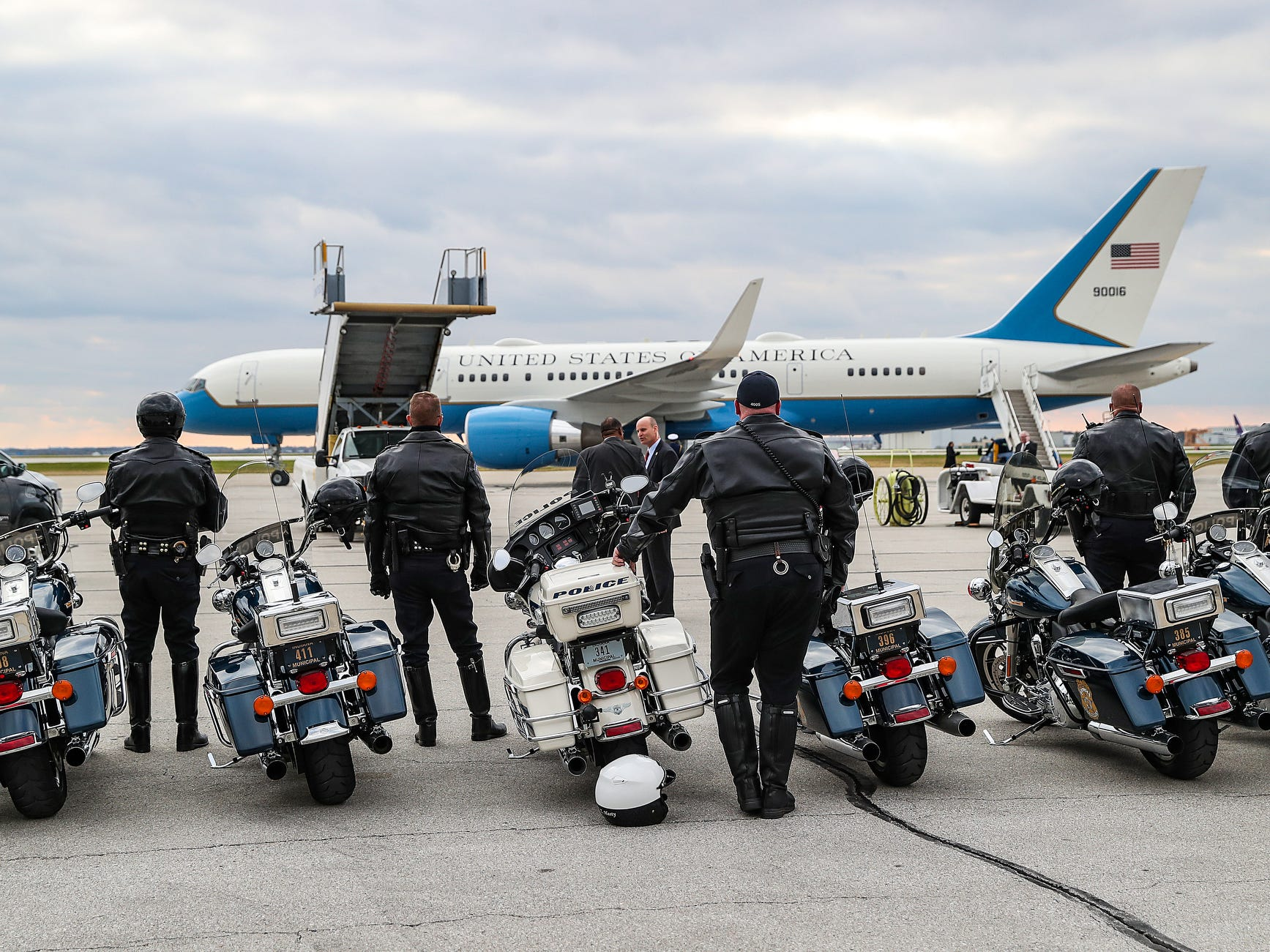 Indianapolis law enforcement officers watched as Air Force One, transporting President Donald Trump, prepared to depart after he spoke at the Future Farmers of America Convention and Expo at Banker's Life Fieldhouse, Saturday, Oct. 27, 2018. Trump was headed to Illinois next to speak at a rally.