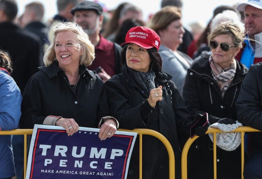 Greeters wait for President Donald Trump at the Indianapolis International Airport, where he arrived Saturday morning to speak to at the FFA convention at Bankers Life Fieldhouse in Indianapolis, Oct. 27, 2018.