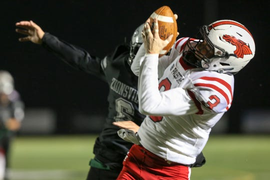 New Palestein's Blake Austin (3) and Zionsville's Jake Naspinski (6) fight for control of a pass during the first half of Zionsville vs New Palestein High School varsity football in the semi-final round of the Class 5A State Sectional Championship held at Zionsville High School, Friday, October 26, 2018.