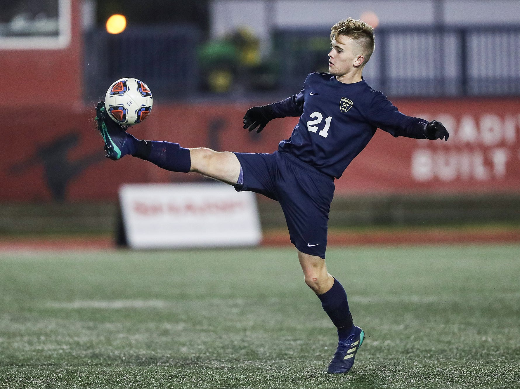 Hammond Bishop Noll Warriors midfielder Noah Reid (21) stops the ball during the second half of IHSAA class 2A state finals at IUPUI's Michael A. Carroll Stadium in Indianapolis, Friday, Oct. 26, 2018. Hammond Bishop Noll defeated Cardinal Ritter, 1-0.
