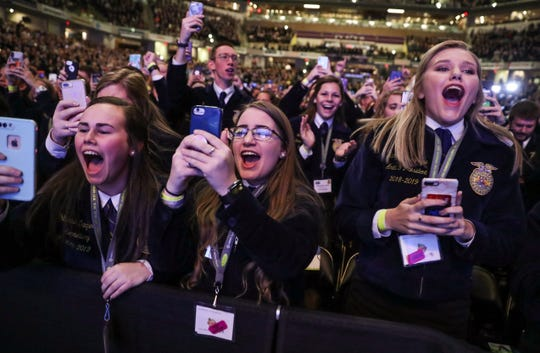 FFA attendees cheer in the front row as U.S. President Donald Trump takes the stage to speak at the National FFA Organization's annual convention at Bankers Life Fieldhouse in Indianapolis, Saturday, Oct. 27, 2018.
