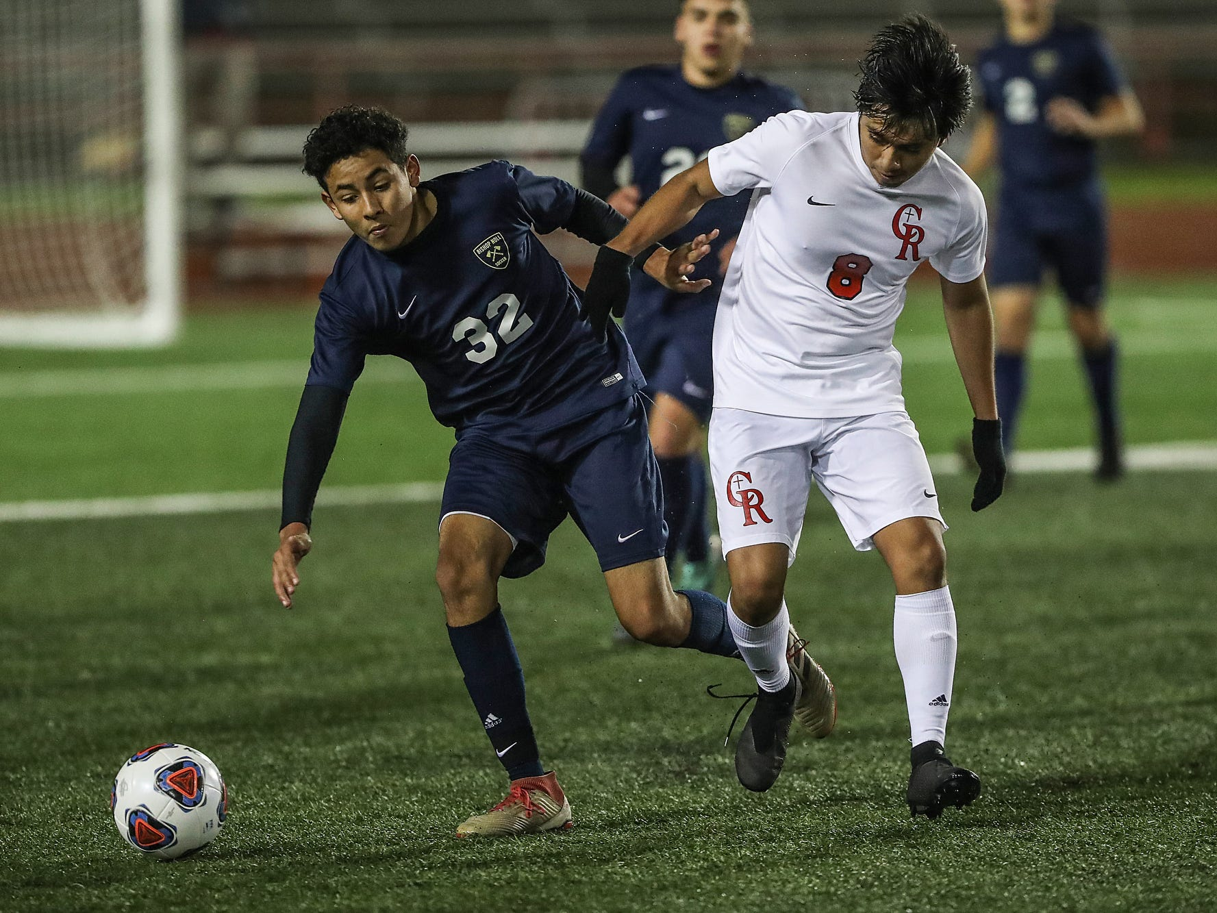Hammond Bishop Noll Warriors midfielder Miguel Gonzalez (32) and Cardinal Ritter Raiders Erick Martinez (8) go after the ball during the second half of IHSAA class 2A state finals at IUPUI's Michael A. Carroll Stadium in Indianapolis, Friday, Oct. 26, 2018. Hammond Bishop Noll defeated Cardinal Ritter, 1-0.