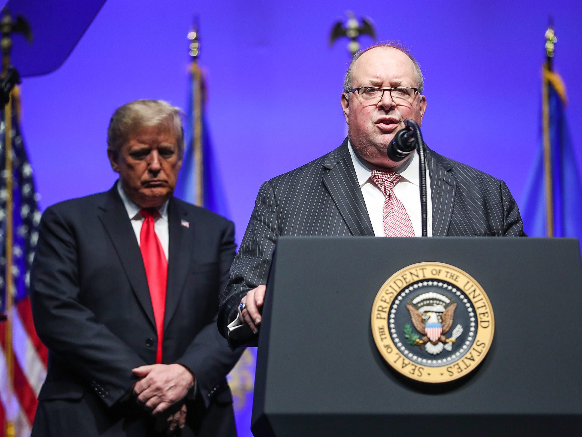 United States President Donald Trump listens as Rabbi Benjamin Sendrow says a prayer in light of the morning's synagogue shooting in Pittsburgh, during Trump's speech at the annual Future Farmers of America Convention and Expo at Banker's Life Fieldhouse in Indianapolis, Saturday, Oct. 27, 2018.