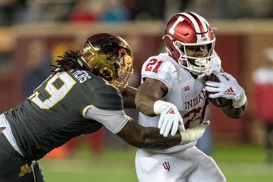 Indiana Hoosiers running back Stevie Scott (21) rushes with the ball past Minnesota Golden Gophers defensive lineman Gary Moore (19) in the first quarter at TCF Bank Stadium.