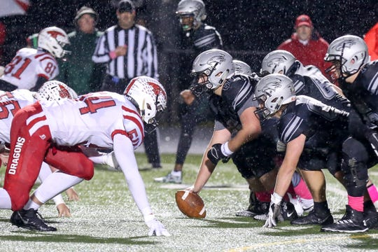 The teams prepare for the snap during the first half of Zionsville vs New Palestein High School varsity football in the semi-final round of the Class 5A State Sectional Championship held at Zionsville High School, Friday, October 26, 2018.