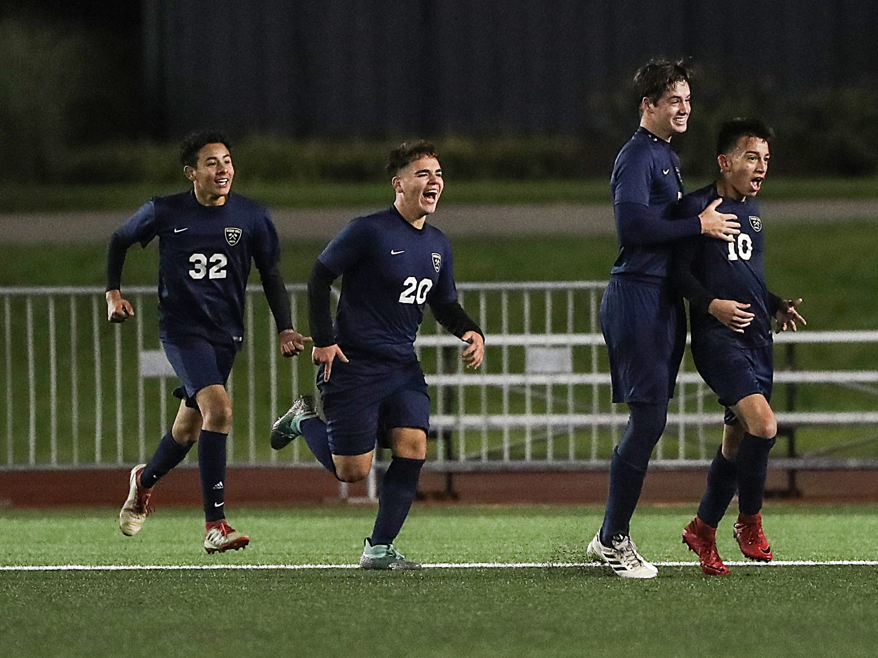 The Hammond Bishop Noll Warriors celebrate a goal by Bruno Zamora (10) during the second half of IHSAA class 2A state finals at IUPUI's Michael A. Carroll Stadium in Indianapolis, Friday, Oct. 26, 2018. Hammond Bishop Noll defeated Cardinal Ritter, 1-0.