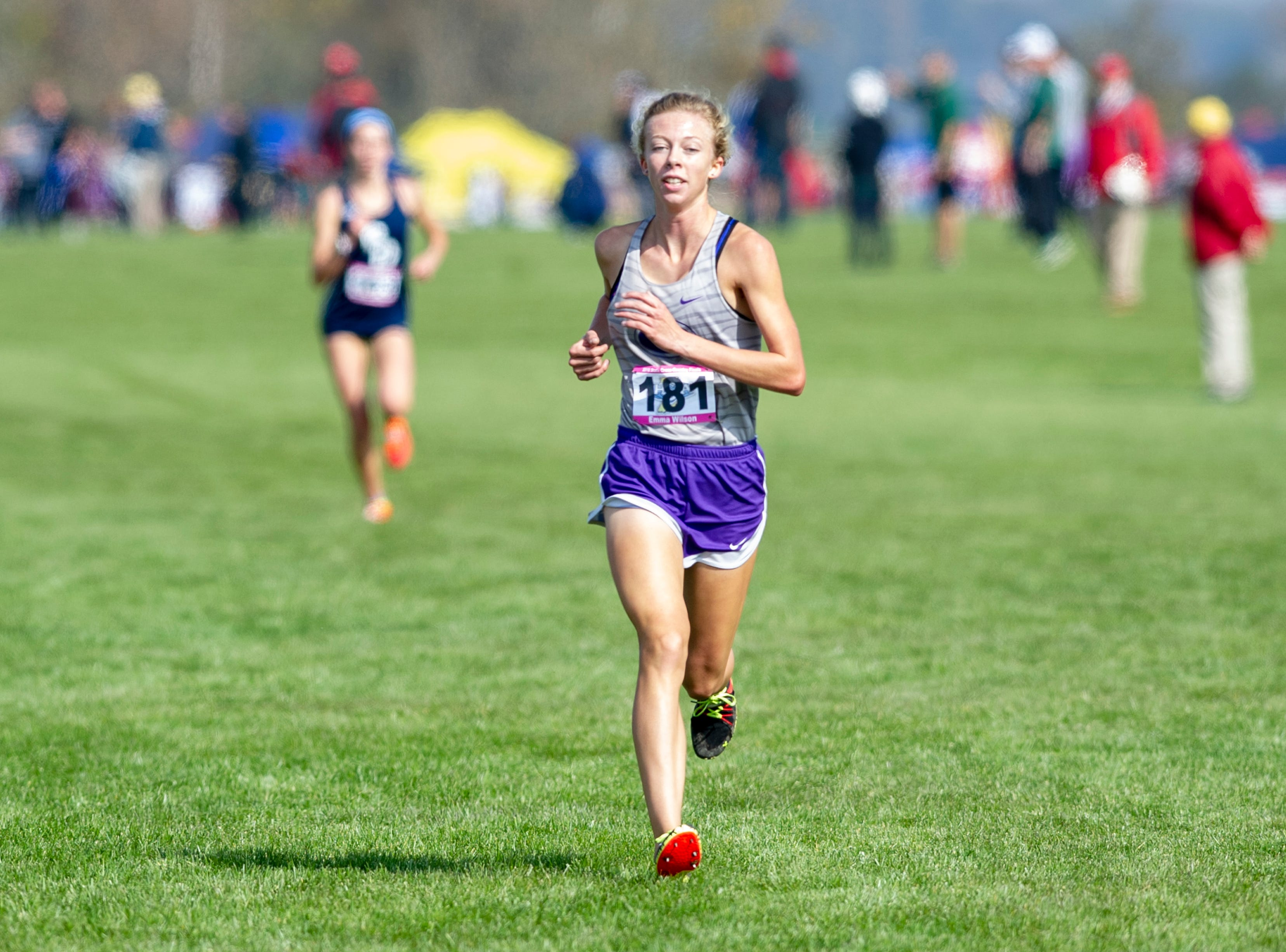 Greencastle High School runner Emma Wilson (181) leads the entire field along the course during the running of the IHSAA Boys' and Girls' Cross Country State Finals meet Saturday, Oct. 27, 2018, at The Lavern Gibson Championship Cross Country Course at Terre Haute.