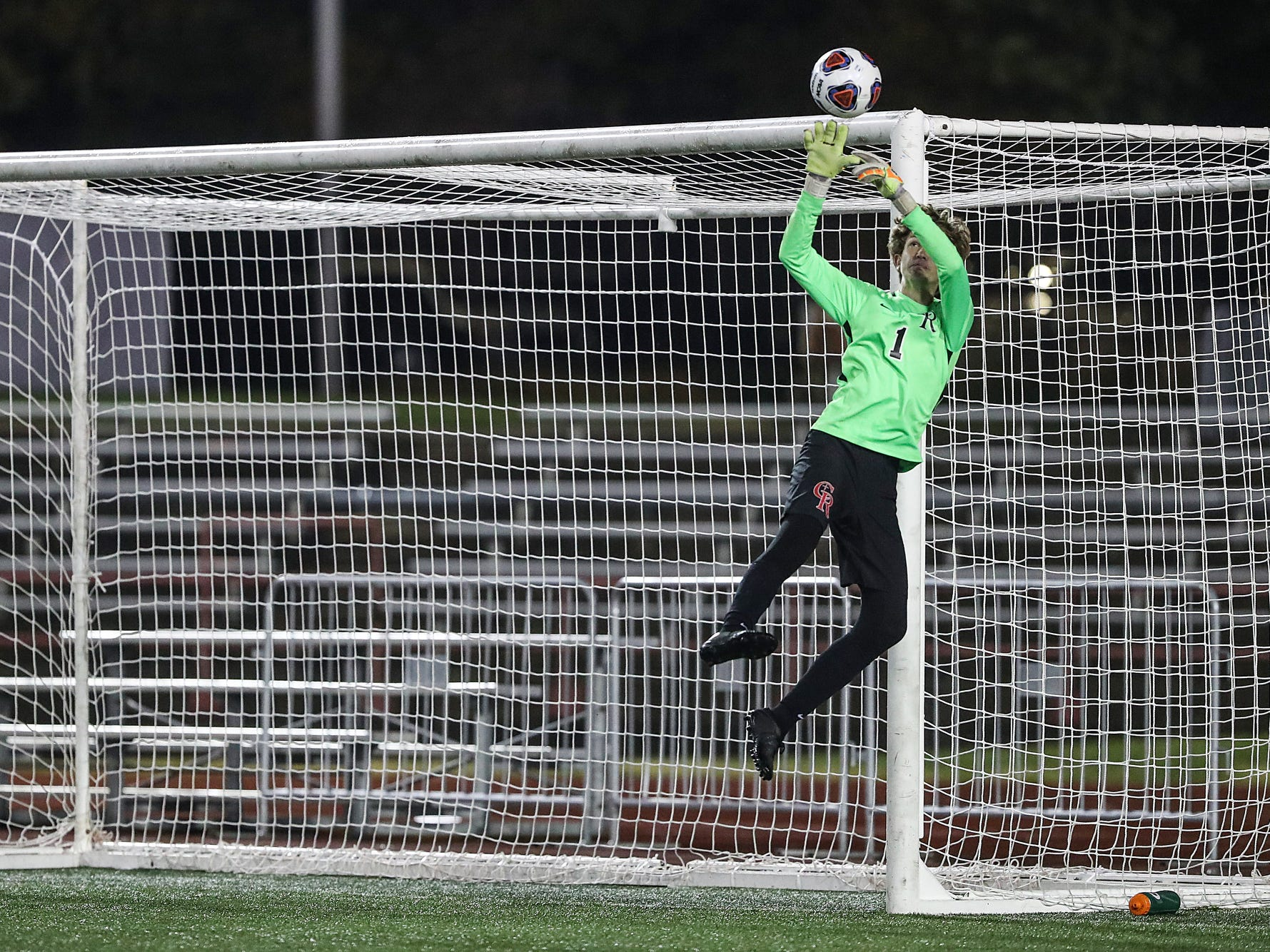 Cardinal Ritter Raiders goalkeeper Hayden Grider (1) stops a shot by the Hammond Bishop Noll Warriors during the second half of IHSAA class 2A state finals at IUPUI's Michael A. Carroll Stadium in Indianapolis, Friday, Oct. 26, 2018. Hammond Bishop Noll defeated Cardinal Ritter, 1-0.