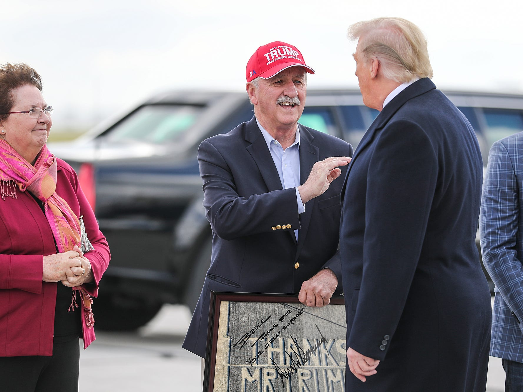 From right, United States President Donald Trump greets Bruce and Virginia Buchanan, owners of Buchanan Farms, on the tarmac at Indianapolis International Airport, where he arrived to speak at the annual Future Farmers of America Convention and Expo at Banker's Life Fieldhouse, Saturday, Oct. 27, 2018.