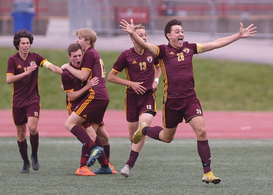Chesterton's defender Jack Eaton (20) reacts after scoring against Zionsville with 27 seconds left on the clock Saturday during overtime in the IHSAA class 3A state final at IUPUI's Michael A. Carroll Stadium in Indianapolis, Ind.