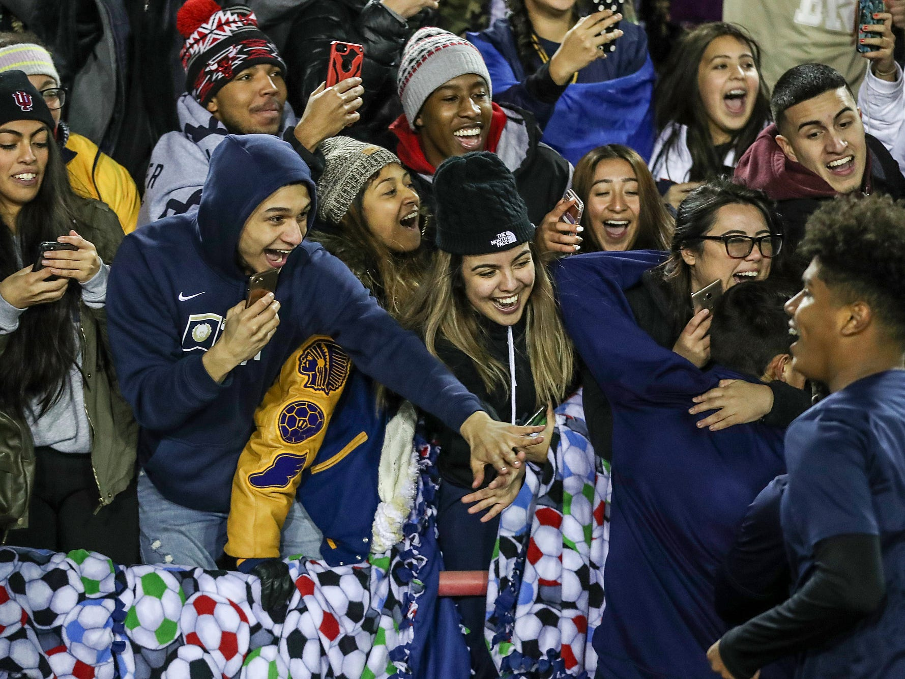 Hammond Bishop Noll players celebrate with the student section after defeating Cardinal Ritter 1-0 in IHSAA class 2A state finals at IUPUI's Michael A. Carroll Stadium in Indianapolis, Friday, Oct. 26, 2018.