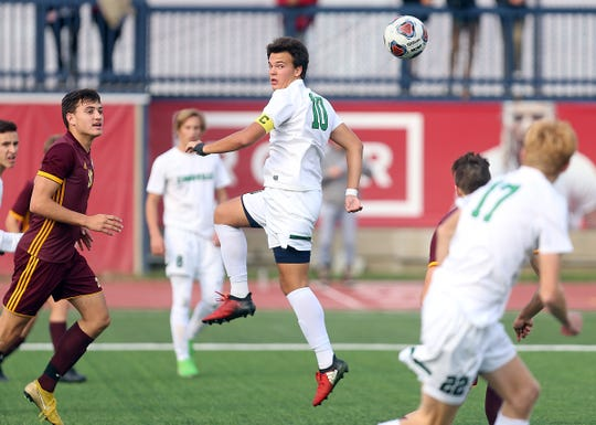 Zionsville's Jack Seamands (10) heads the ball against Chesterton in the second half of the IHSAA class 3A state final.