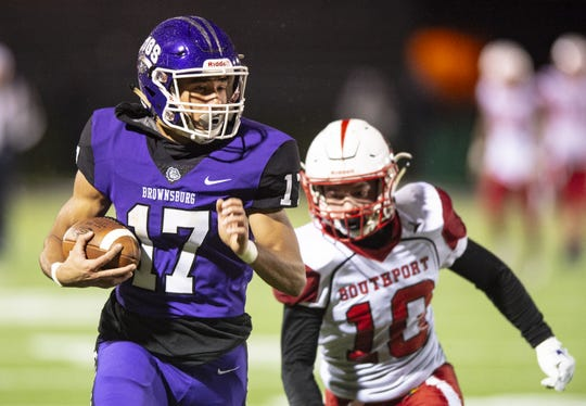 Brownsburg High School senior Bryce Kirtz (17) pulls in a pass and runs into the end zone to score on a 57-yard pass play during the first half of action. Brownsburg High School hosted Southport High School in the 2018-19 IHSAA Football State Tournament Class 6A first-round sectional game Friday, Oct. 26, 2018.