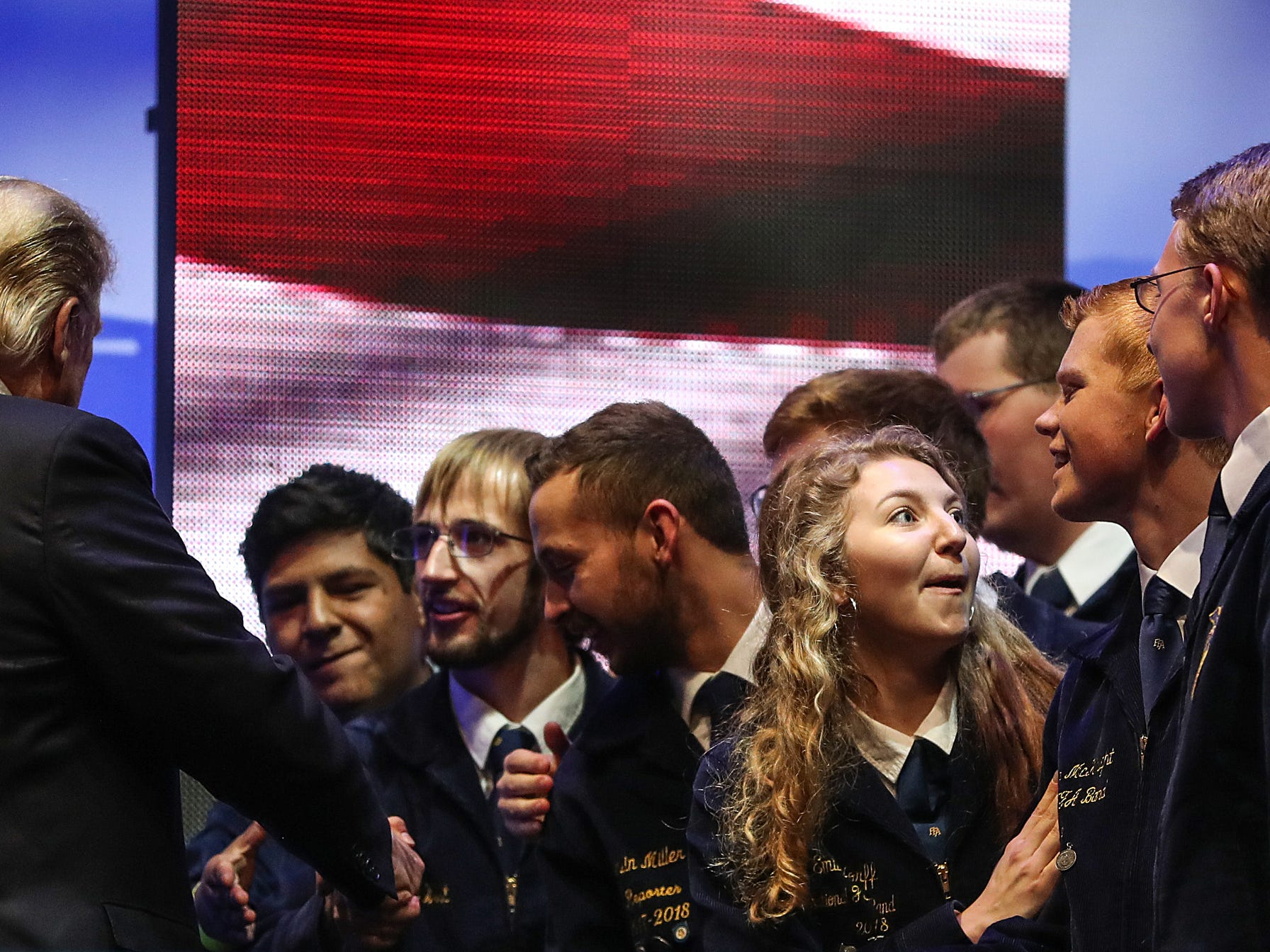 United States President Donald Trump greets attendees before speaking at the annual Future Farmers of America Convention and Expo at Banker's Life Fieldhouse, Saturday, Oct. 27, 2018.