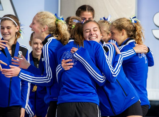 The team from Carroll High School in Fort Wayne celebrate their victory after the running of the IHSAA Boys' and Girls' Cross Country State Finals meet Saturday, Oct. 27, 2018, at The Lavern Gibson Championship Cross Country Course at Terre Haute.