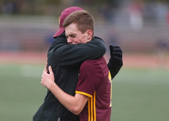 Chesterton's Robbie Capehart (7) is embraced after Chesterton defeated Zionsville in the IHSAA class 3A state final at IUPUI's Michael A. Carroll Stadium in Indianapolis, Ind., Saturday, Oct. 27, 2018. Chesterton defeated Zionsville 1-0 in overtime.
