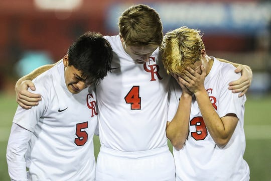 From left, Cardinal Ritter Raiders Manuel Lopez (5), John Wagoner (4) and Scott Roggeman (3) show dejection after they lost to Hammond Bishop Noll in IHSAA class 2A state finals at IUPUI's Michael A. Carroll Stadium in Indianapolis, Friday, Oct. 26, 2018. Hammond Bishop Noll won, 1-0.