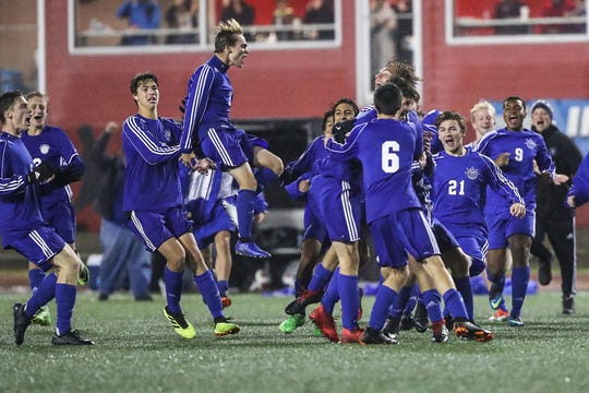 The Fort Wayne Canterbury Cavaliers celebrate winning IHSAA class A state finals at IUPUI's Michael A. Carroll Stadium in Indianapolis, Friday, Oct. 26, 2018.  The final score was Fort Wayne Canterbury 0*, Covenant Christian 0 (6-5). Fort Wayne Canterbury's Joel Groninger scored on his team's sixth attempt in penalties after Covenant Christian missed theirs.