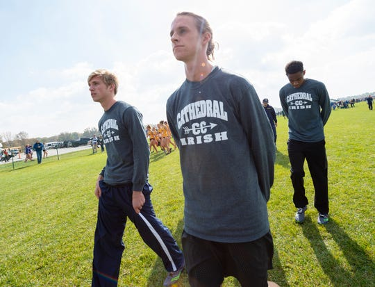 Cathedral High School runner Cole Hocker, center, prepares for the race before the running of the IHSAA Boys' and Girls' Cross Country State Finals meet Saturday, Oct. 27, 2018, at The Lavern Gibson Championship Cross Country Course at Terre Haute. Hocker went on to win the event in a time of 15:25.1.
