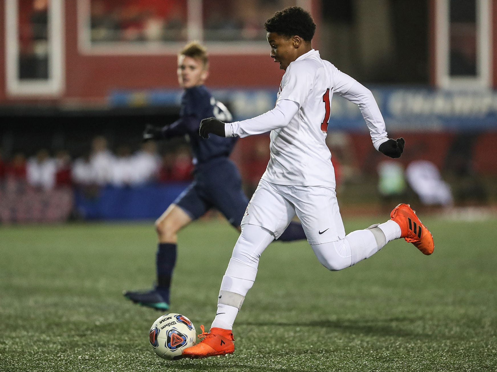 Cardinal Ritter Raiders midfielder Chris Murray (14) moves the ball during the second half of IHSAA class 2A state finals at IUPUI's Michael A. Carroll Stadium in Indianapolis, Friday, Oct. 26, 2018. Hammond Bishop Noll defeated Cardinal Ritter, 1-0.