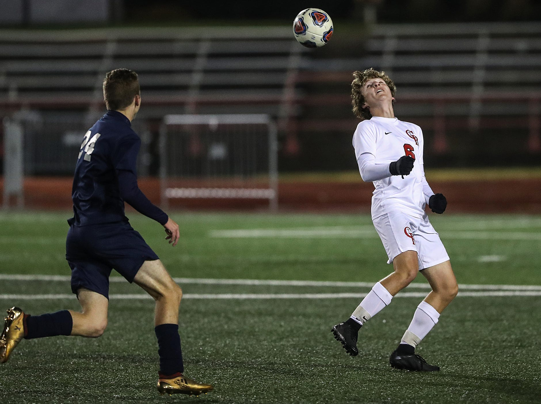 At right, Cardinal Ritter Raiders Luke Lauer (6) during the second half of IHSAA class 2A state finals at IUPUI's Michael A. Carroll Stadium in Indianapolis, Friday, Oct. 26, 2018. Hammond Bishop Noll defeated Cardinal Ritter, 1-0.