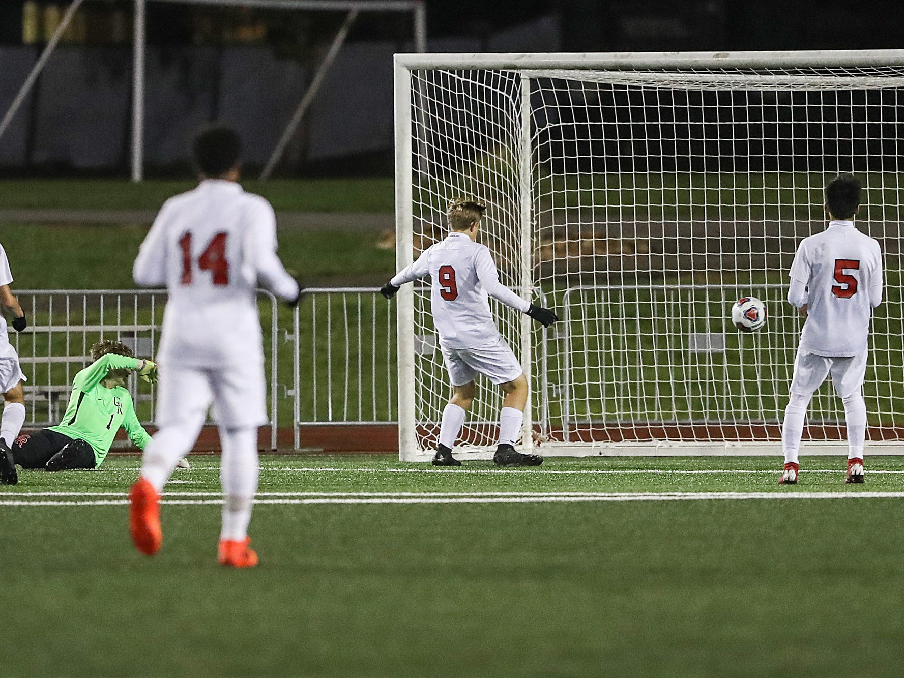 The Cardinal Ritter Raiders are unable to stop a goal by Hammond Bishop Noll Warriors midfielder Bruno Zamora (10) during the second half of IHSAA class 2A state finals at IUPUI's Michael A. Carroll Stadium in Indianapolis, Friday, Oct. 26, 2018. Hammond Bishop Noll defeated Cardinal Ritter, 1-0.