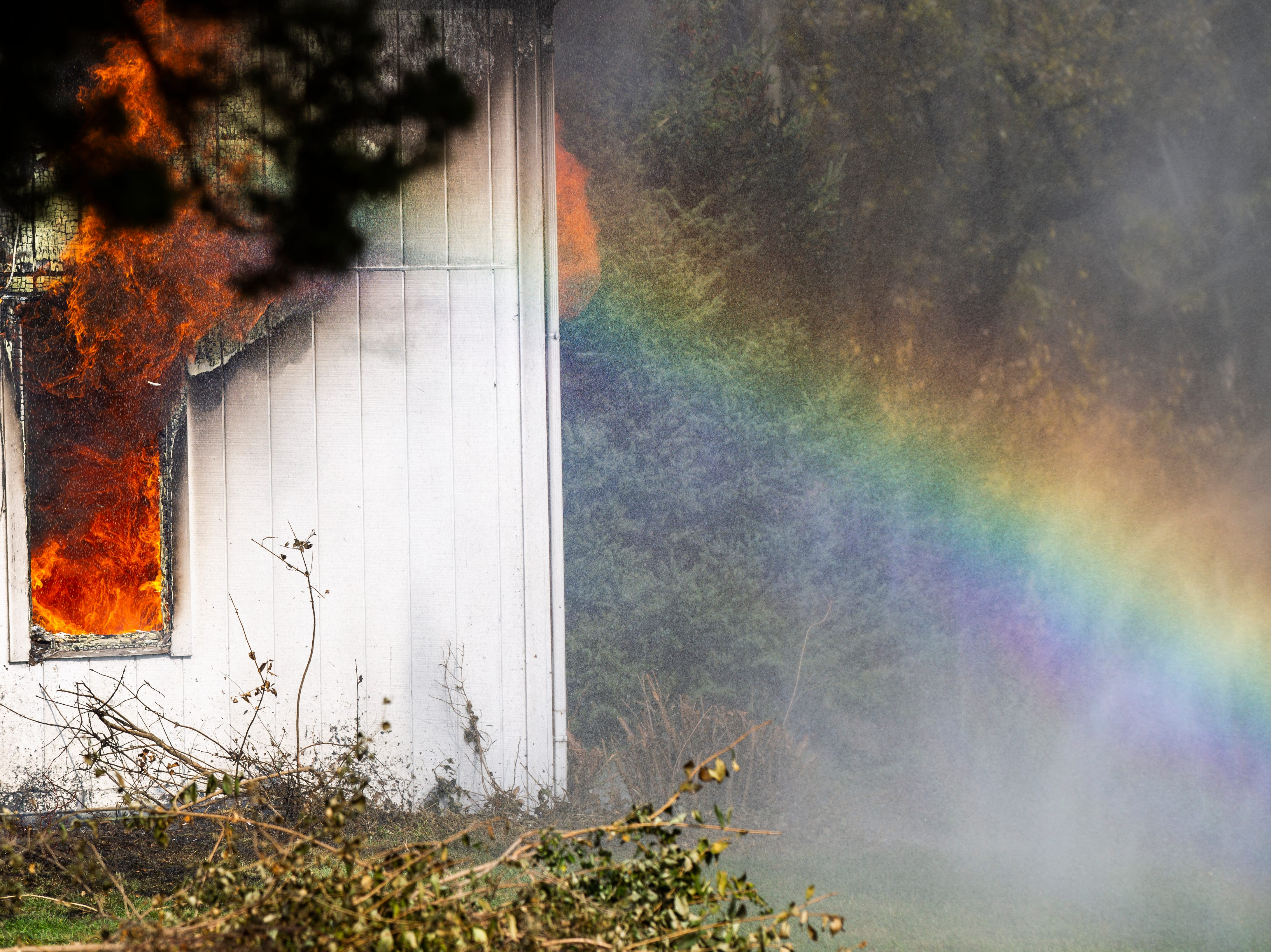North Liberty Fire Department conducts a controlled burn fire training exercise of a farm house on Saturday, Oct. 27, 2018, on the east side of Liberty High School in North Liberty.