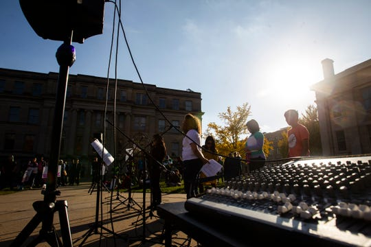 """Elizabeth Bernal speaks during the """"Rally for Immigration Reform"""" on Saturday, Oct. 27, 2018, on the east side the Pentacrest in Iowa City."""